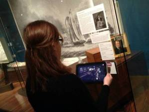 Marketing Associate, Jen LaBella, demos one of the tablets.
